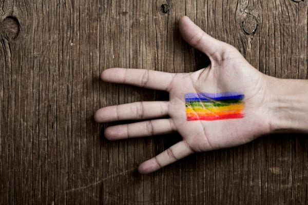 Rainbow flag on hand